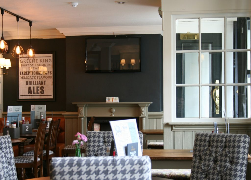 Kings Arms Pub bury St Edmunds fireplace and dining tables